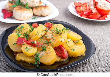 Stewed potatoes with bell pepper and onions, meatballs of minced meat