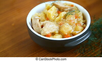 stewed potatoes with vegetables, cabbage and meat in a bowl...