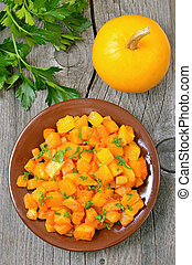 Stewed pumpkin on wooden table, top view