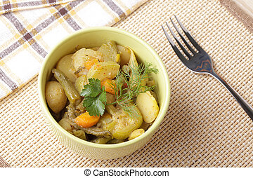Stewed vegetables in pottery on table