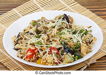 stewed vegetables with rice on a plate on a wooden background