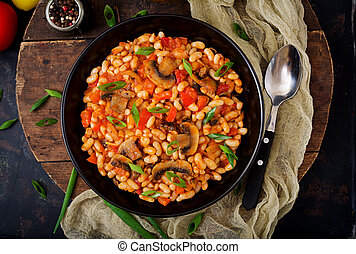 Stewed white beans with mushrooms and tomatoes with spicy...
