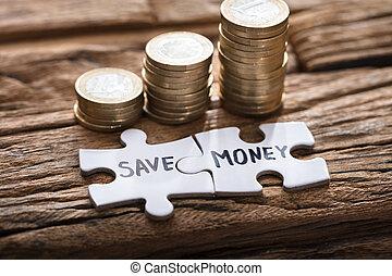 stichsaege, gestapelt, geld, geldmünzen, stücke, retten