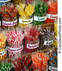 Stick Candy - Brightly colored stick candy in clear glass...