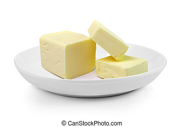 Stick of butter in plate on white background