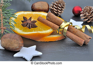 stick of cinnamon in golden ribbon