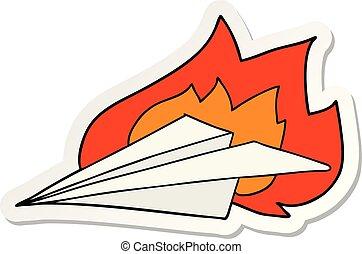 sticker of a cartoon burning paper airplane