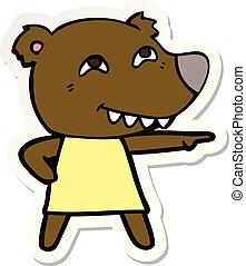 sticker of a cartoon pointing bear girl showing teeth
