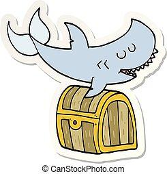 sticker of a cartoon shark swimming over treasure chest