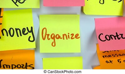 Sticker with the word organize stick on a white board -...