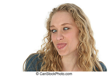 Sticking Tongue Out - Beautiful blond girl sticking out her...