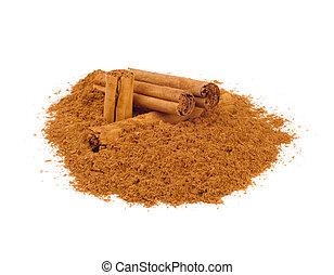 Sticks and ground ceylon cinnamon on white table