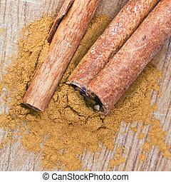 sticks and powdered Cinnamon spice close up