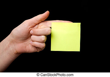 Sticky Note - A blank sticky note stuck to a hand - remember...