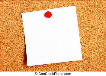 Sticky note hanging on corkboard
