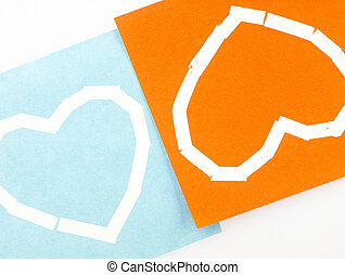 Sticky note, heart and white backgrounds.