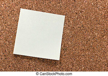 sticky note on a corkboard