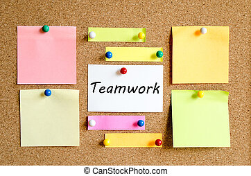 Sticky Note On Cork Board Background And Teamwork Text...