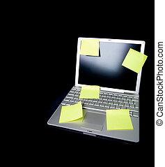 Sticky Note on Laptop - A sticky note on a laptop computer -...