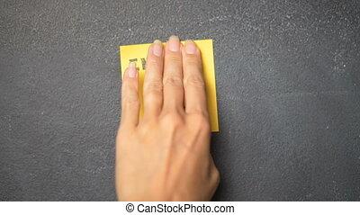 Sticky note on the blackboard