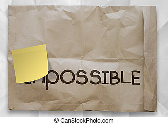 sticky note over word impossible transformed into possible as concept