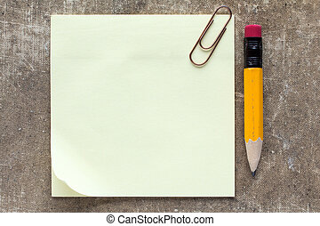 Sticky note paper with paperclip and pencil