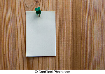 sticky note - yellow sticky note on a wooden background