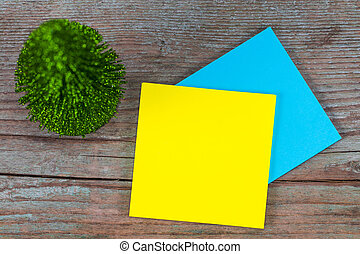 sticky note with empty space for a text and Christmas tree on wooden background