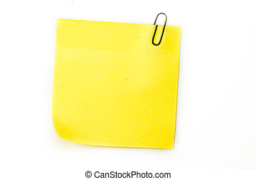Sticky note with grey paperclip against a white background