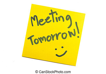 """Sticky note with text """"Meeting Tomorrow"""""""