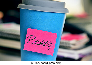 sticky note with the word reliability in a cup