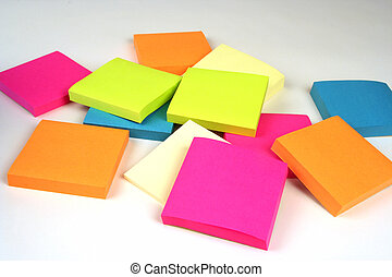 Colorful sticky notes in a pile on a white background