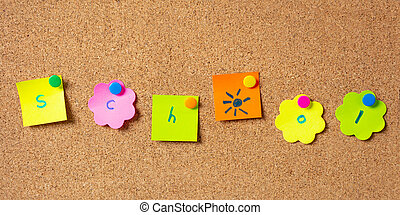 Sticky notes with letters with pushpins, colorful in various shapes and blank space, isolated on cork background.
