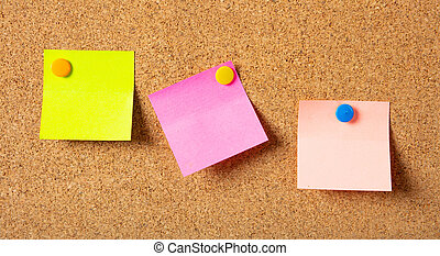 Sticky notes with pushpins, colorful and blank space, isolated on cork background,