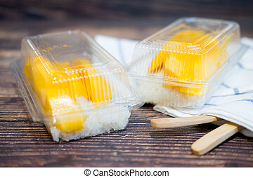 Sticky rice coconut milk with mango in clear plastic box