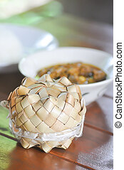 sticky rice in the basket with soup