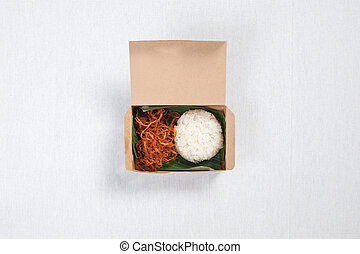 Sticky rice with shredded pork put in a brown paper box, put on a white tablecloth, food box, Thai food.