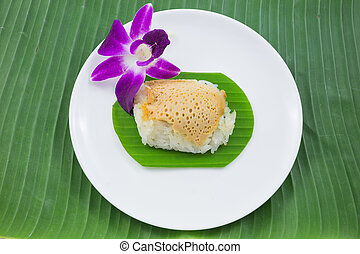 sticky rice with steamed custard on banana leaves and dish ...