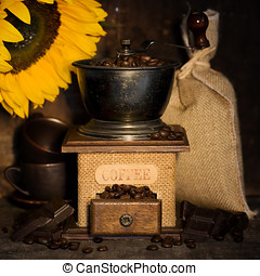 Stiill life with Antique coffee grinder and sunflower -...