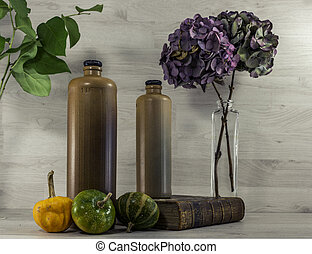 stil life  with stone bottles on wooden background