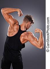 stilig, muskulös, man, framställ, på, den, grå, bakgrund., begrepp, av, frisk livsstil