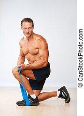 stilig, muskulös, man, gör, sträckande, exercise.