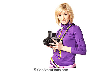 Stilish girl holding retro camera