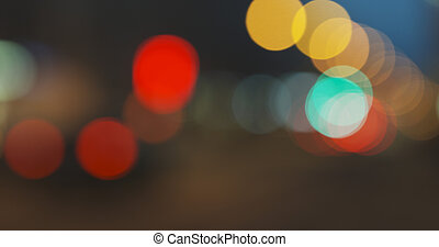 still blur background of night city with moving cars and walking people
