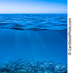 still calm sea water surface with clear sky and underwater ...