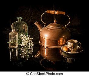 Still life antique brass tea pot, cup, flower