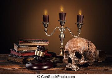 Still life art photography on human skull skeleton with...
