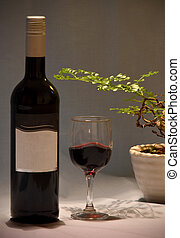 Still life, bottle and glass of wine