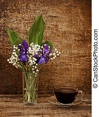 Still-life bouquet of lily of the valley with blue irises