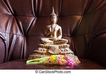Still Life Buddha Statue With Garland